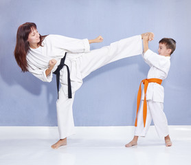 Mother and son are training kick leg