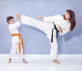Sports family are training kick leg