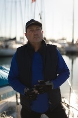 Yachtsman standing on the boat