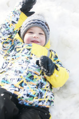 Little boy playing in the snow, portrait