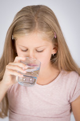 Close up of a girl drinking water