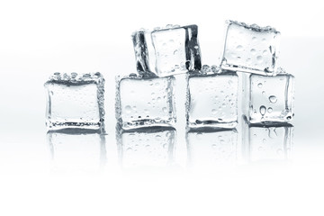 Transparent ice cubes with water drops isolated on white background