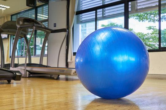 exercise ball for fitness on wooden floor.