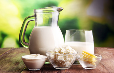 Poster Produit laitier milk products. tasty healthy dairy products on a table