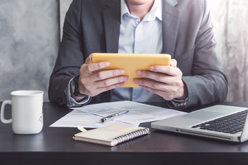 Close up of Businessman using Tablet on the office desk.