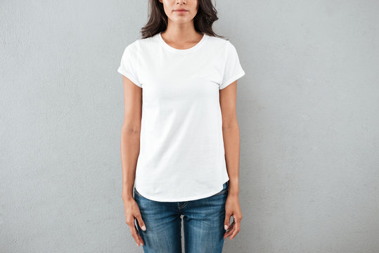 Cropped image of a young woman dressed in t-shirt