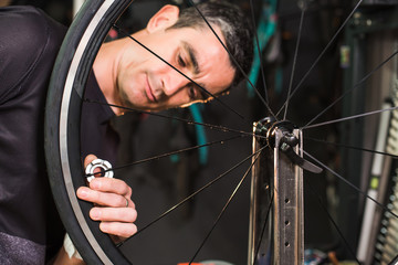 Male technician repairing a bike