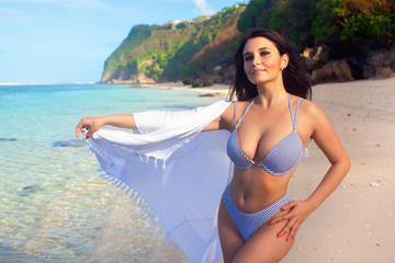 Beautiful girl posing on the sandy beach