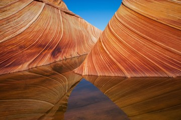 River Amidst Rock Formations At Coyote Buttes