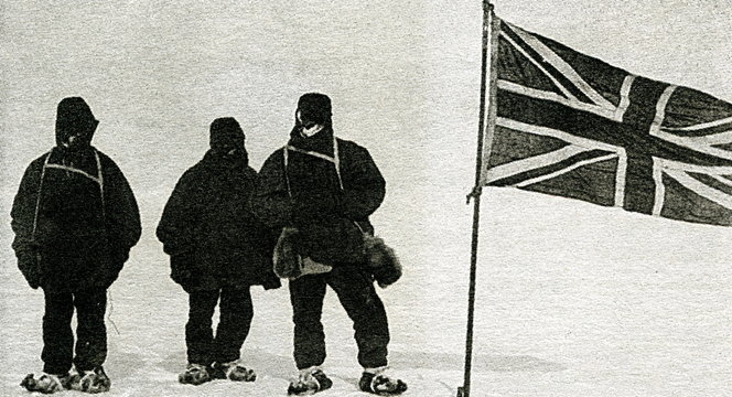 Jameson Adams, Frank Wild and Eric Marshall (from left to right) plant the Union Jack at 88° 23', on 9 January 1909. Photograph by Ernest Shackleton.