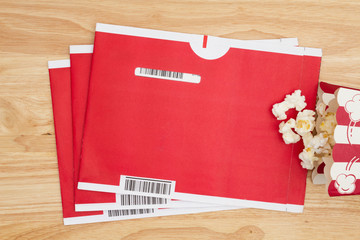 Red mailing envelopes with popcorn