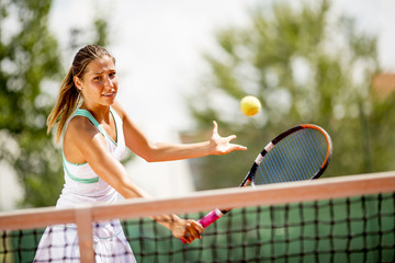 Young woman playing tennis outdoor