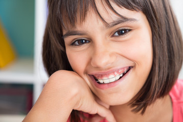 Beautiful smile with orthodontic appliance