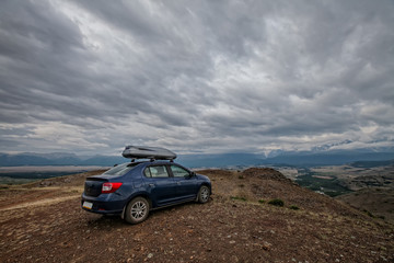 Journey on a beautiful blue car in the mountains
