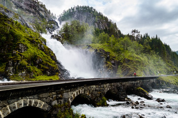 Powerful waterfall next to the road in Norway,