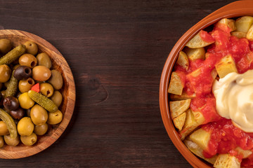 Patatas bravas and olives, Spanish tapas with copy space