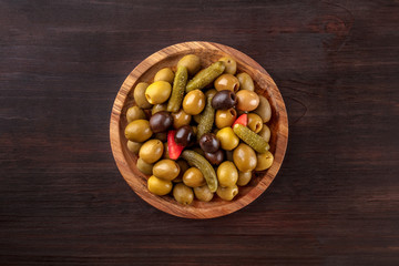 Overhead photo of pickled olives with copy space