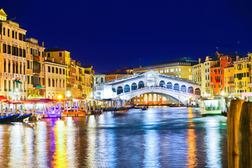 View of the Rialto Bridge and Grand Canal in Venice at night