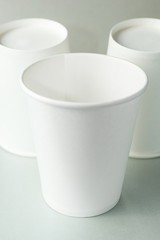 Empty white cup of coffee, tea or juice on isolated gray background, mockup.