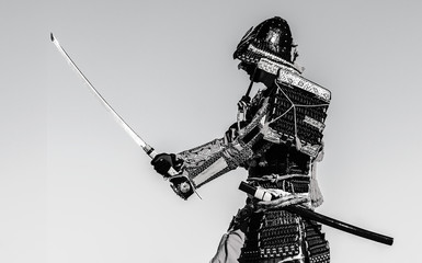 Samurai warrior with sword, isolated on the black background.