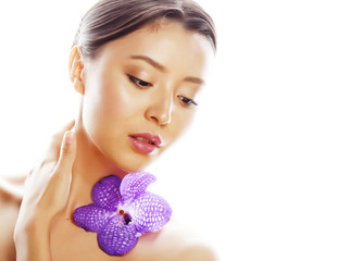 young pretty asian woman with flower purple orchid close up isol