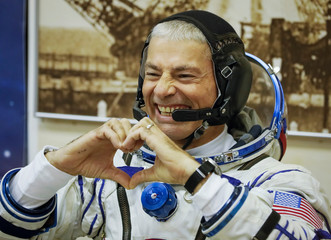 The International Space Station (ISS) crew members Mark Vande Hei of the the U.S., gestures after donning space suit shortly before his launch at the Baikonur Cosmodrome