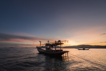 Thai taxi boat at sunset in Andaman sea Thailand.