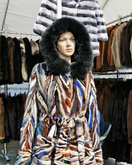 Fashionnable hooded fur coat on mannequin