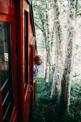 woman poking out a funicular window