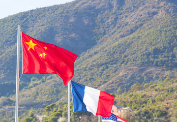 Flag, Chinese,French, American, Flag in a brisk breeze against a bright blue sky in summer background.
