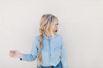 Woman agains white wall