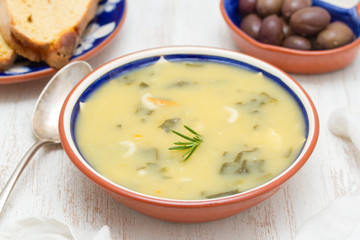 vegetable soup in bowl and olives with corn bread