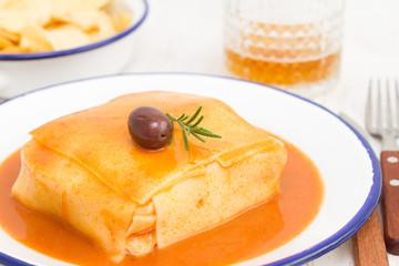 tradirional portuguese dish francesinha on dish