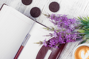Flowers notebook mobile phone cup of coffee biscuits