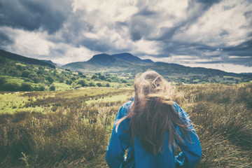Young Girl Outdoors with Hair Blown on the WInd