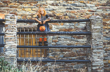 Kid in costume posing on fence