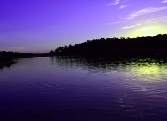 Blue Lake Sunset/Blue and Yellow Sunset reflection on a lake.