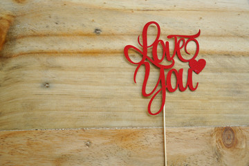 Top or flat lay view of Photo booth props a red text Love You on a wooden background flat lay. Birthday parties and weddings.