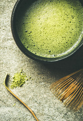 Flat-lay of freshly brewed Japanese matcha tea in Chasen bowl, top view