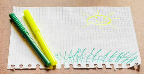 Children's picture with felt-tip pens, the sun. Two felt-tip pen