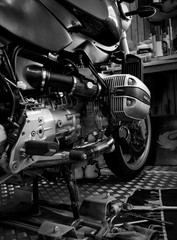 CHONBURI, THAILAND- SEPTEMBER 10, 2017 :Tool on the platform and single cylinder head cover in motorcycle shop,black and white scene, black and white image