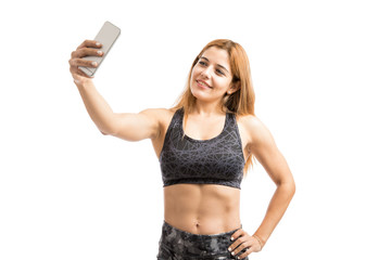 Woman with abs taking a selfie