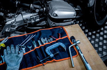 CHONBURI, THAILAND- SEPTEMBER 10, 2017 :Tool set on the table with black and white scene single cylinder head cover in BMW motorcycle shop