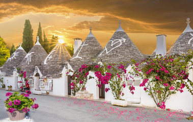 Trulli houses in Alberobello city at sunset time,  Apulia, Italy.