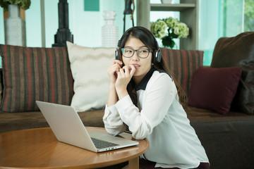 An Asian sexy business woman using a laptop