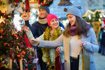 Family of three at Christmas market. Selective focus