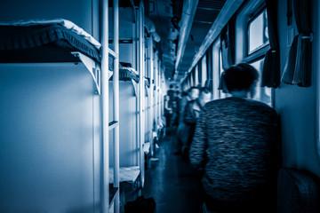 interior view of train in blue tone.