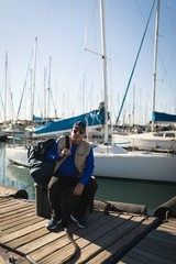 Yachtsman sitting on the pier
