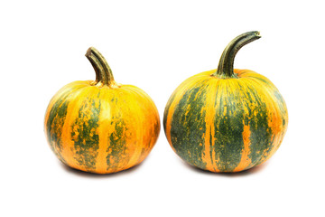 Two orange and green pumpkins with clipping path isolated at white background.