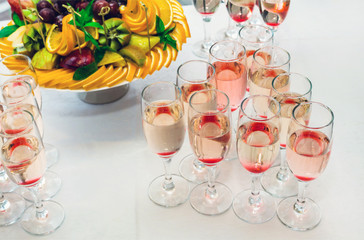 glasses with champagne and fruits